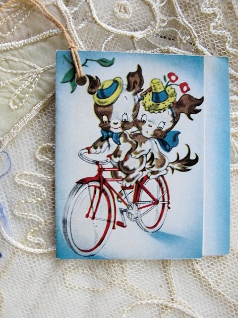 1930s BRIDGE TALLY  TALLIES CARD CUTE DOGS RIDING BICYCLE